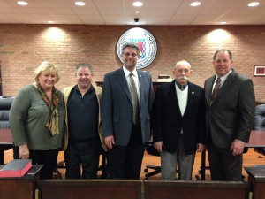 Councilpersons Melissa K. Wagner, Edward Jessup, Joseph Luna, and Gary Baright stand with Town Supervisor Alan Bell (center).
